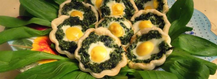 Tartellette di erbette miste e uova di quaglia