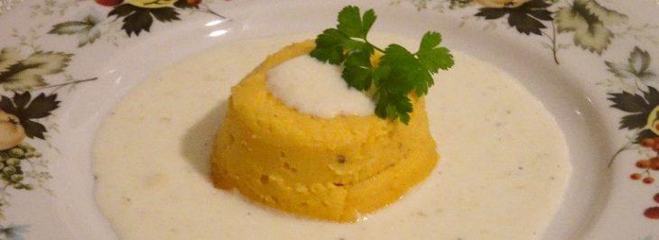 Timballo di patate e zucca su fonduta di grana Padano
